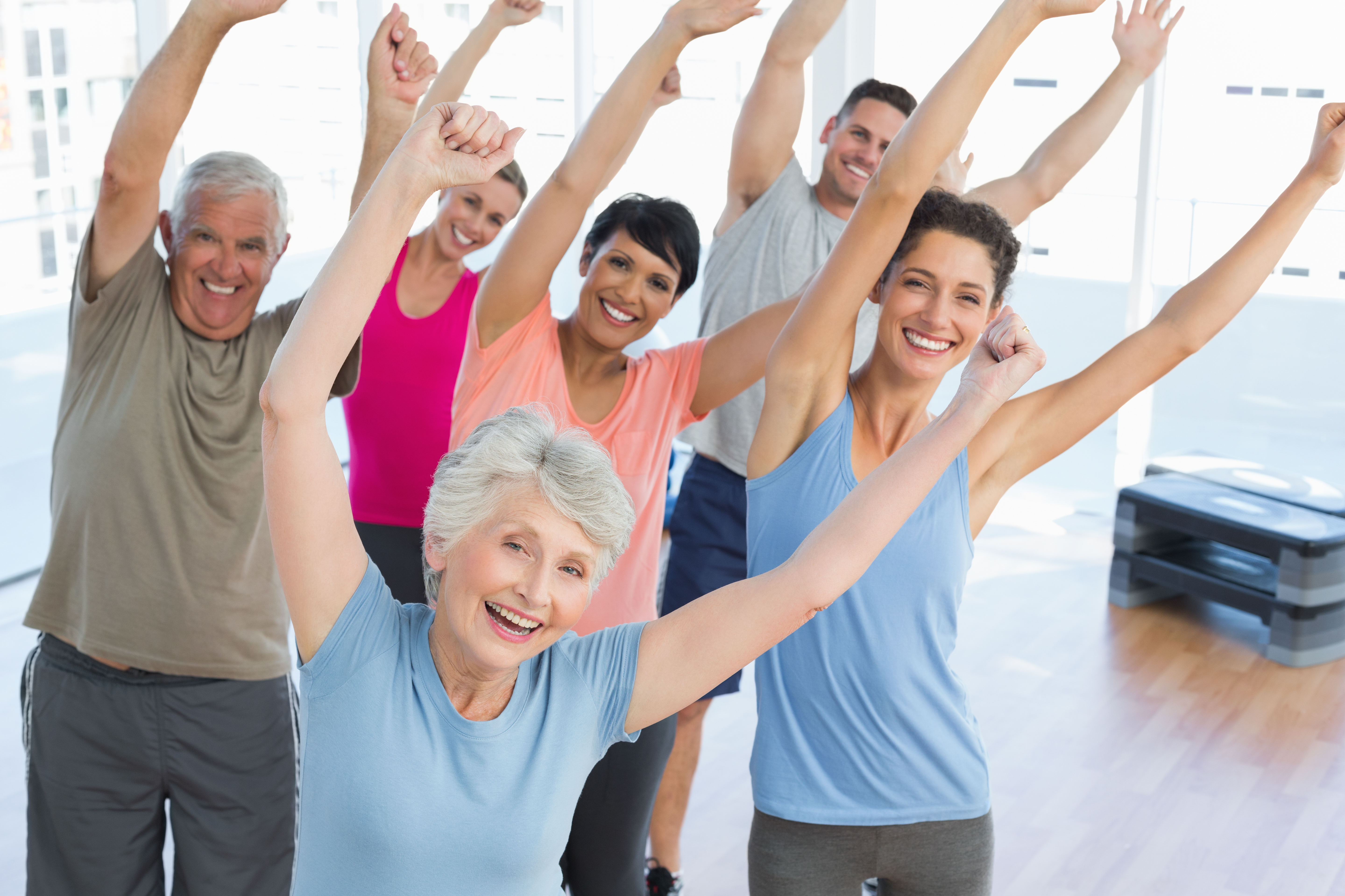 older adults enjoying stretching routine