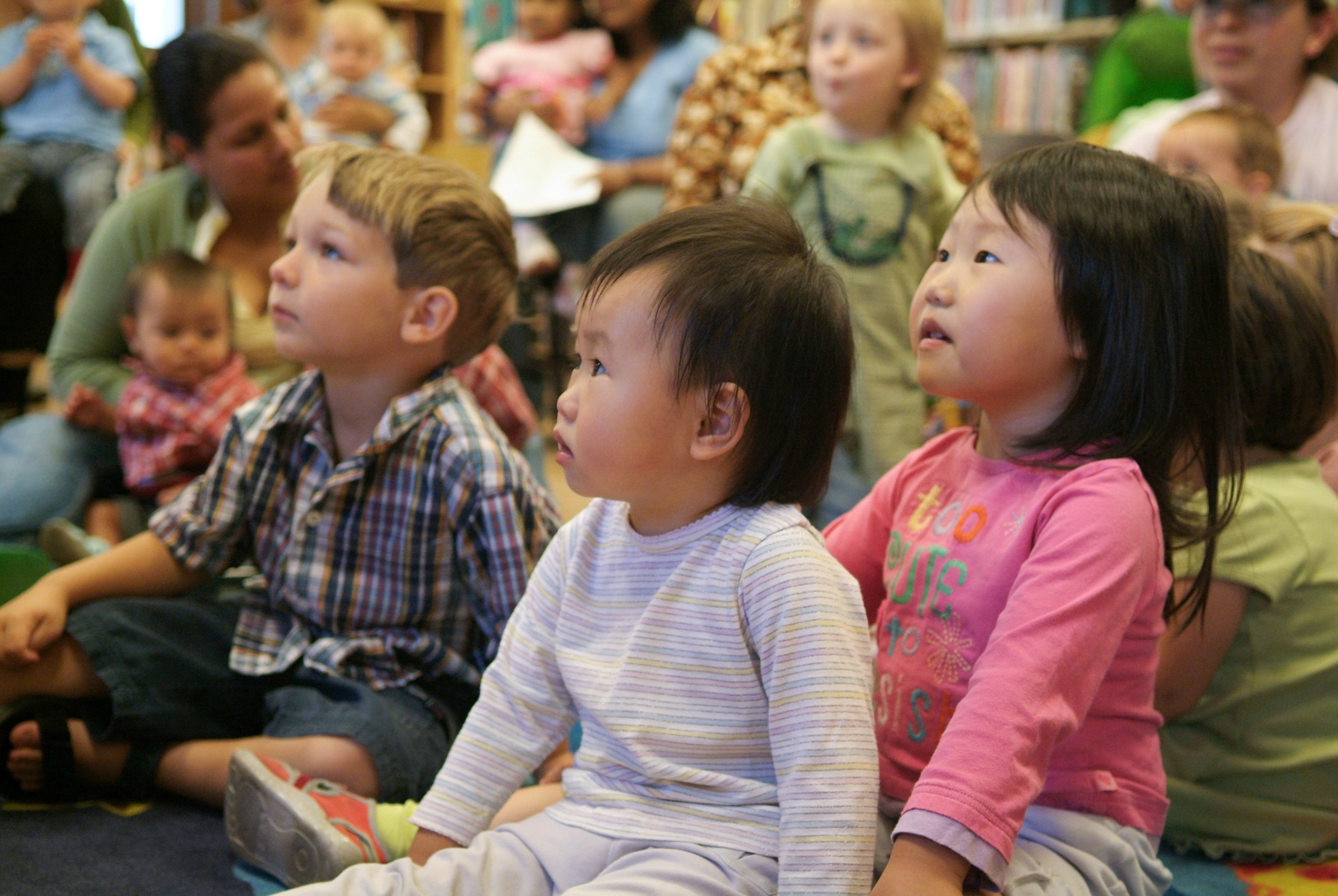 Young children watching storytime presenter