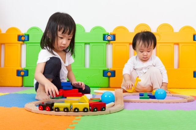 Babies/Toddlers playing with toys