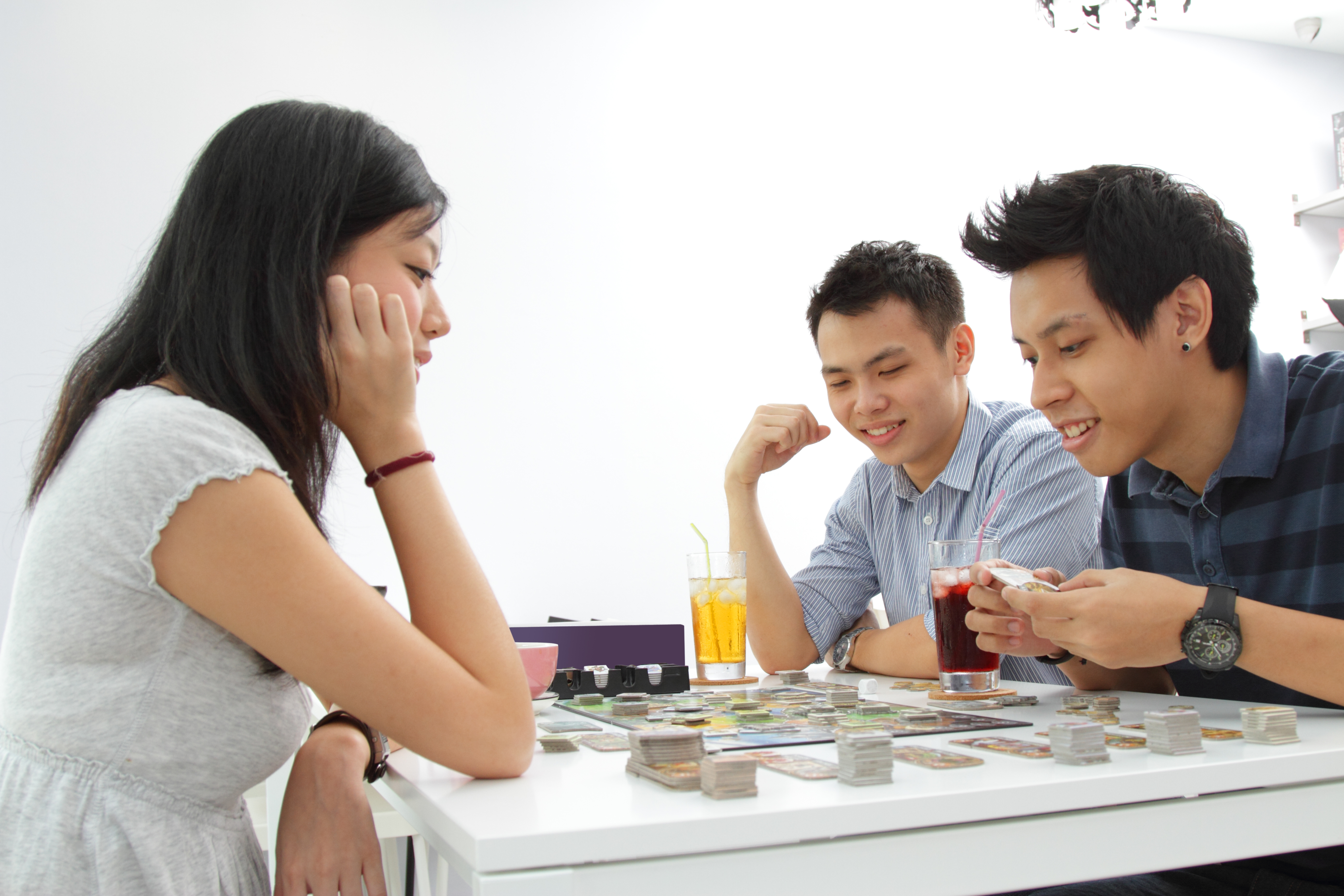 Three adults playing a board game