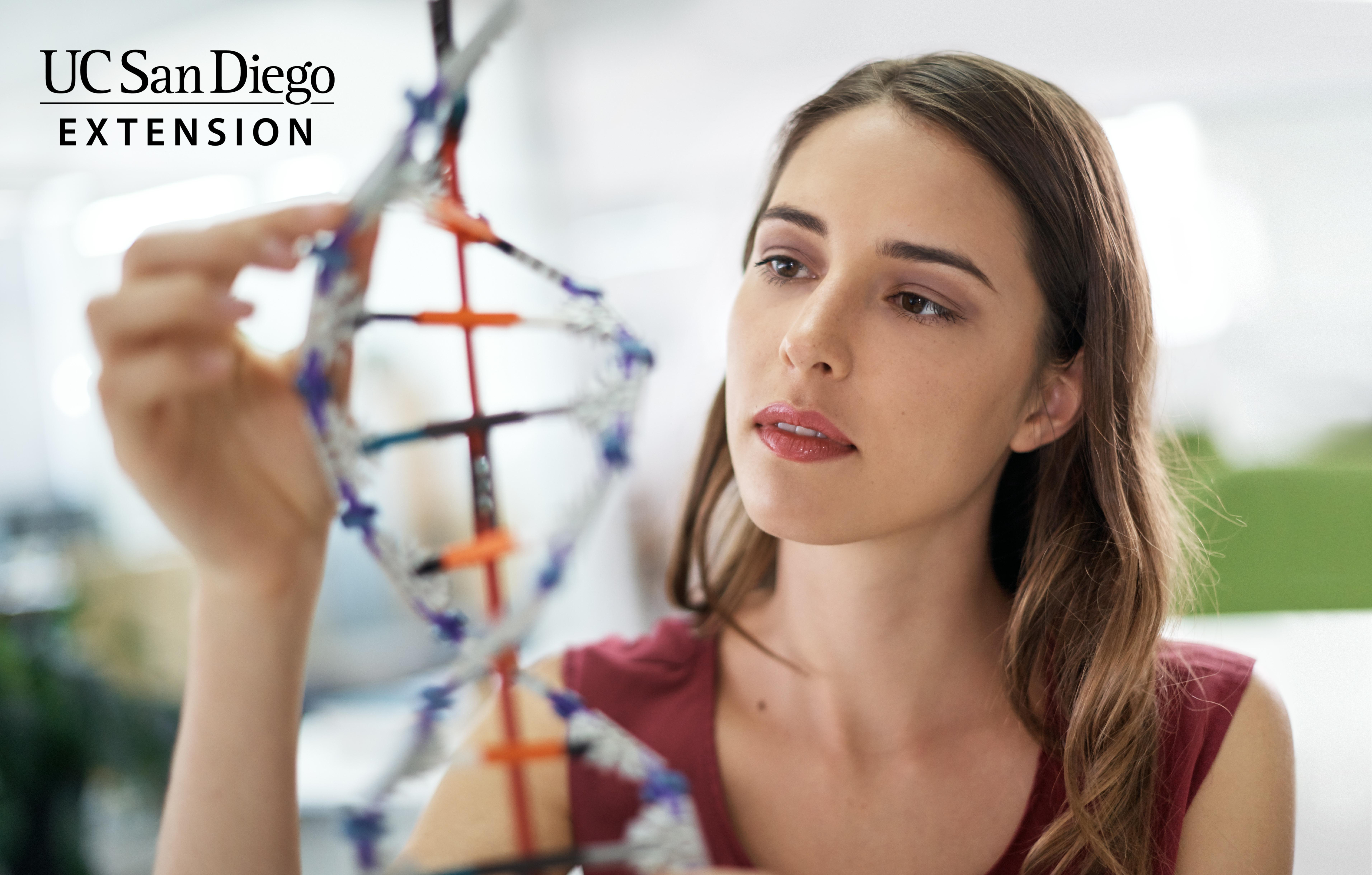 person holding a prop dna helix