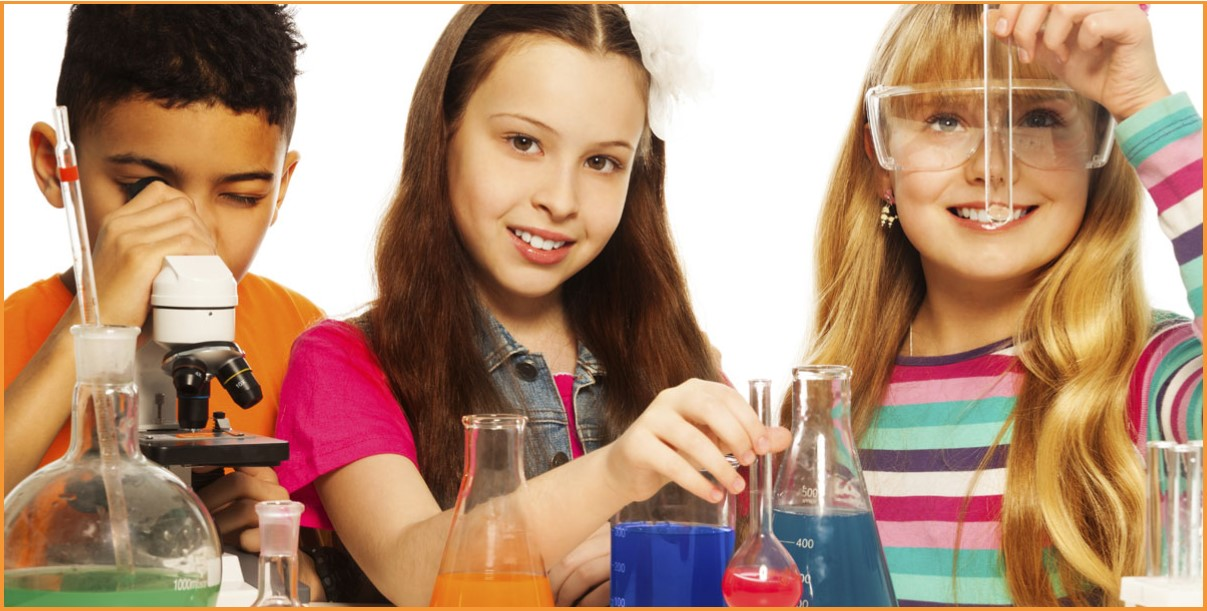 A boy and two girls using a microscope and test tubes