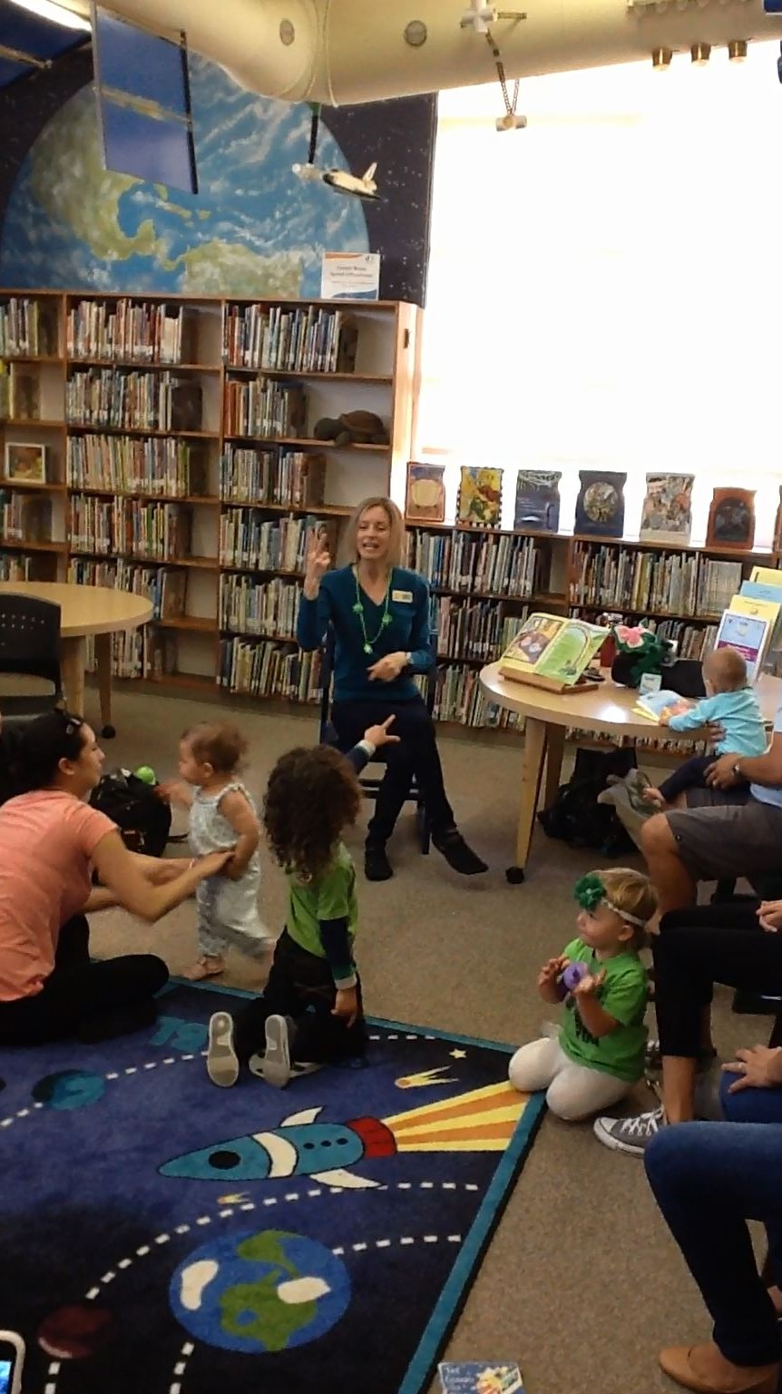 Jennifer Duncan leading sign language storytime.