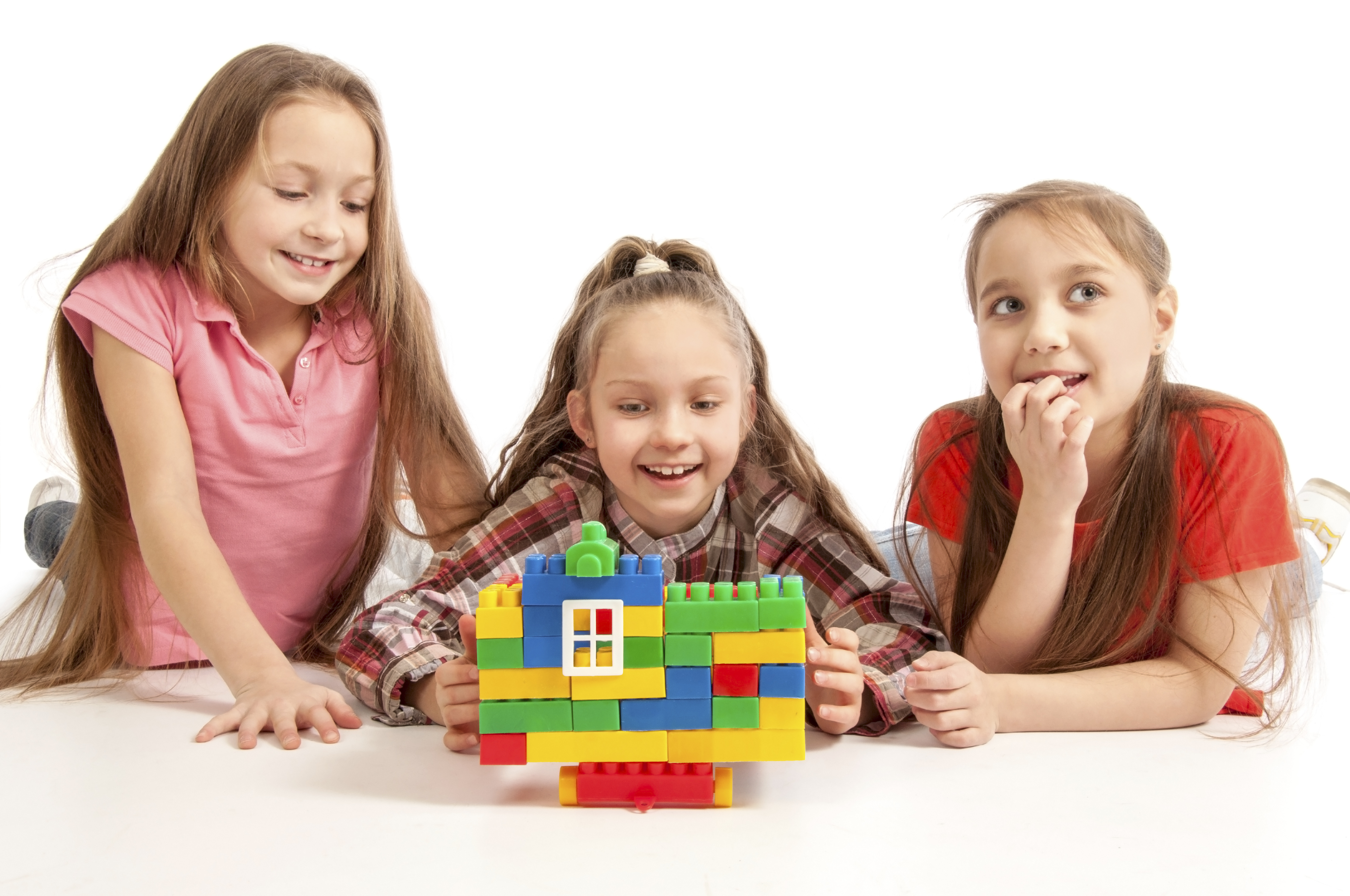 Three girls playing with Legos