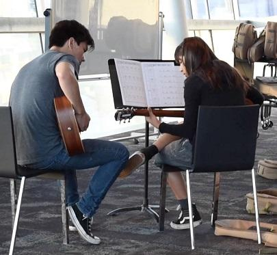 Guitar instructor and student